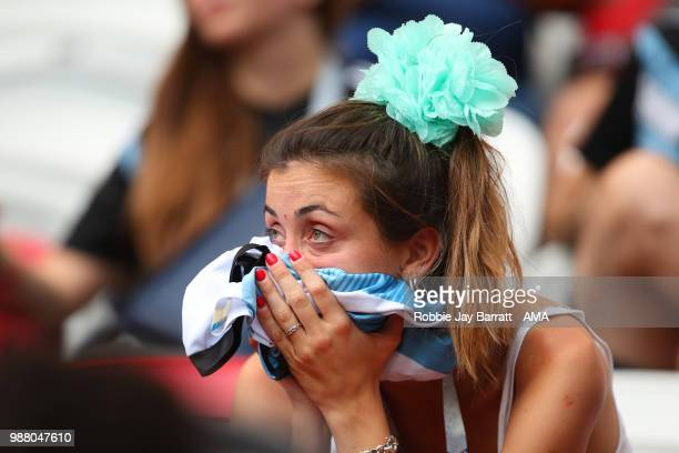 A female fan of Argentina looks dejected at the end of the 2018 FIFA World Cup Russia Round of 16 match between France and Argentina at Kazan Arena...