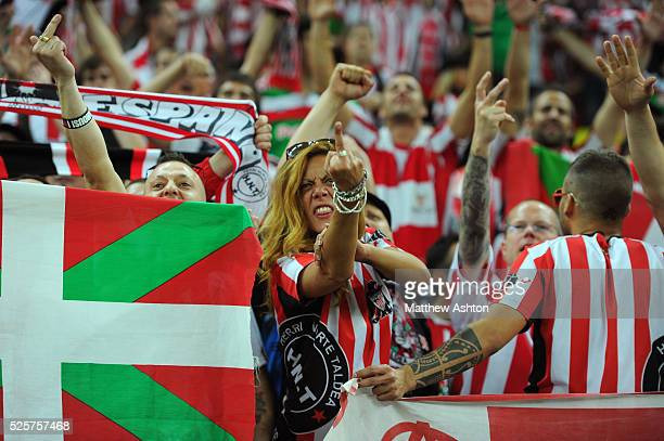 A female fan of Athletic Bilbao at the UEFA Europa League Final 2012 sticking her finger up at rivals Atletico Madrid
