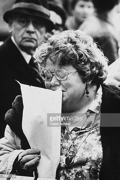 A female fan of British musician John Lennon mourns outside of his residence the Dakota apartment building after his death NYC December 1980