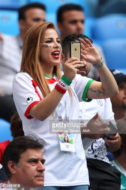 A female fan of Iran takes a photo on her phone during the 2018 FIFA World Cup Russia group B match between Morocco and Iran at Saint Petersburg...