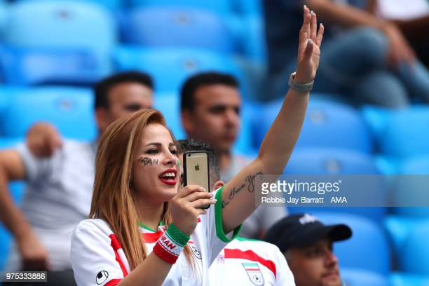 A female fan of Iran waves prior to the 2018 FIFA World Cup Russia group B match between Morocco and Iran at Saint Petersburg Stadium on June 15 2018...