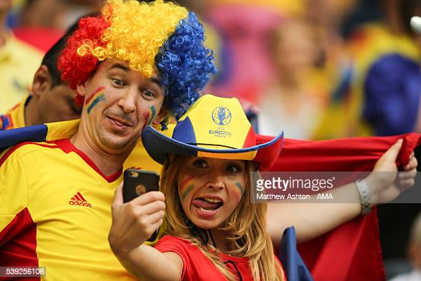 A female fan of Romania takes a selfie of herself using an Apple iPhone during the UEFA EURO 2016 Group A match between France and Romania at Stade...