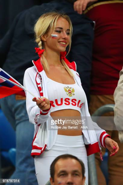 A female fan of Russia looks on during the 2018 FIFA World Cup Russia group A match between Russia and Egypt at Saint Petersburg Stadium on June 19...