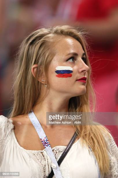 A female fan of Russia looks on during the 2018 FIFA World Cup Russia Quarter Final match between Russia and Croatia at Fisht Stadium on July 7 2018...