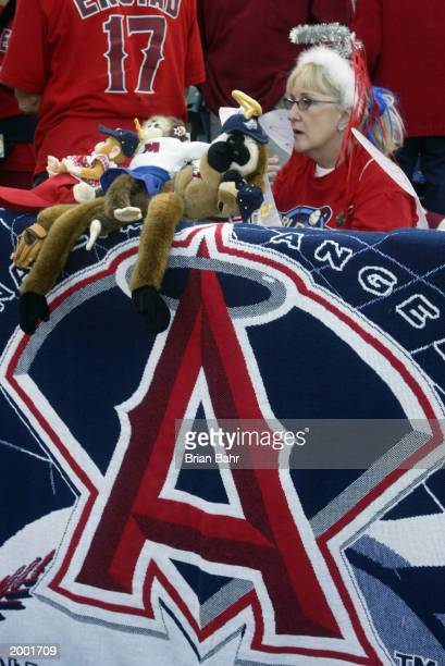 Female fan of the Anaheim Angels displays various rally monkeys on her giant Angels towel from the front row during game seven of the World Series...