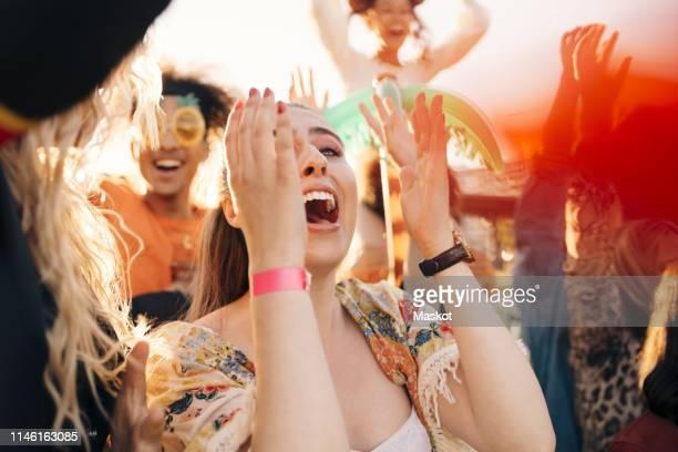 female fan screaming in crowd at music concert - cheering stockfoto's en -beelden