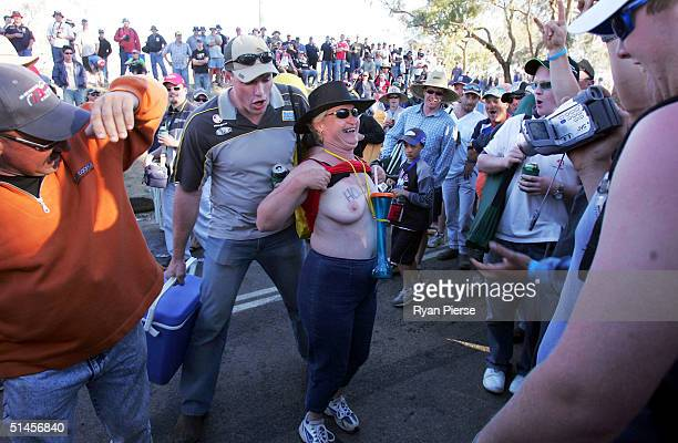 A female fan shows her breasts in the campground at the Bathurst 1000 which is round ten of the 2004 V8 Supercar Championship Series at Mount...