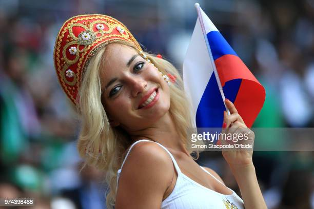 A female fan wearing a traditional Russian hat and flag during the 2018 FIFA World Cup Russia group A match between Russia and Saudi Arabia at...