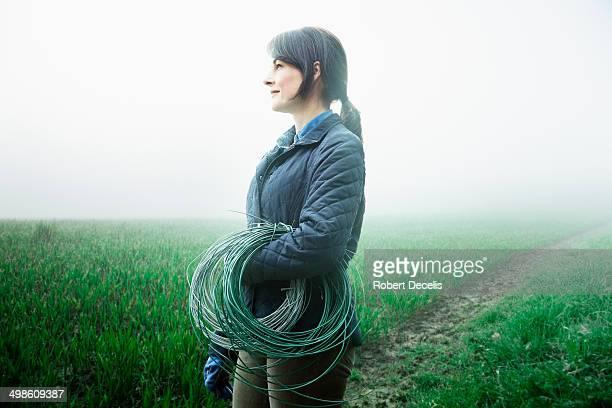 Female farmer about to start work in field