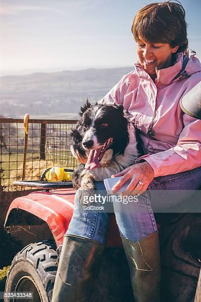 Female Farmer and Her Sheepdog