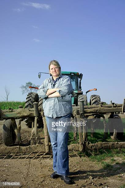 Female farmer behind her tractor and plow.
