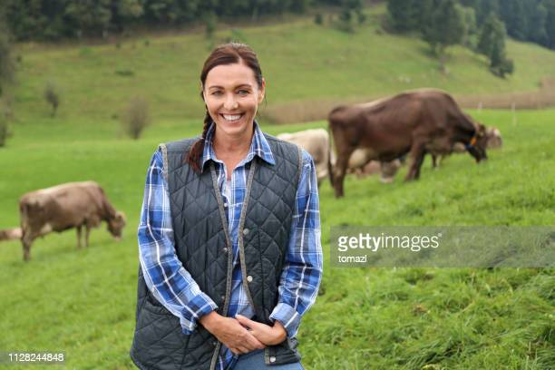 female farmer portrait on pasture - rancher stock pictures, royalty-free photos & images
