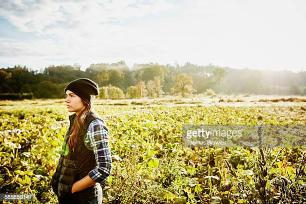 Female farmer standing in organic squash field