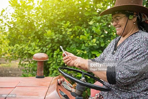 Female farmer using a smartphone