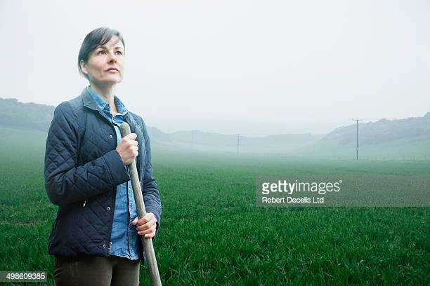Female farmer working in misty field