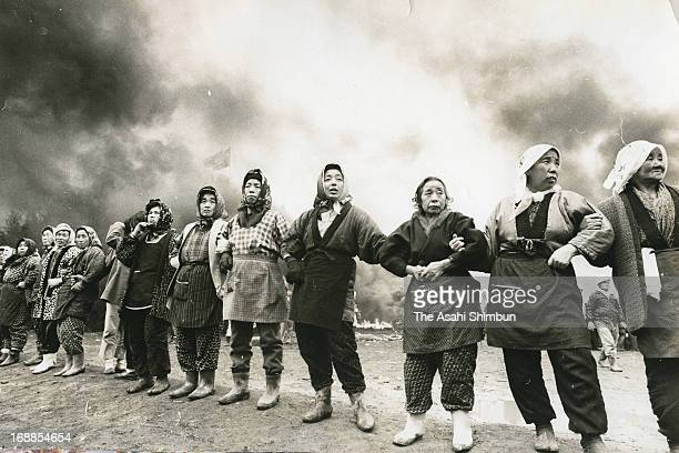 Female farmers form a human chain in protest against the forcible expropriation for the new airport on February 25 1971 in Narita Chiba Japan Narita...