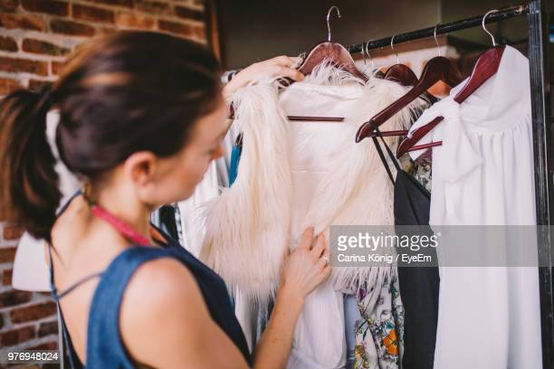 female fashion designer holding clothes on rack at home - eyeem collection stock photos and pictures