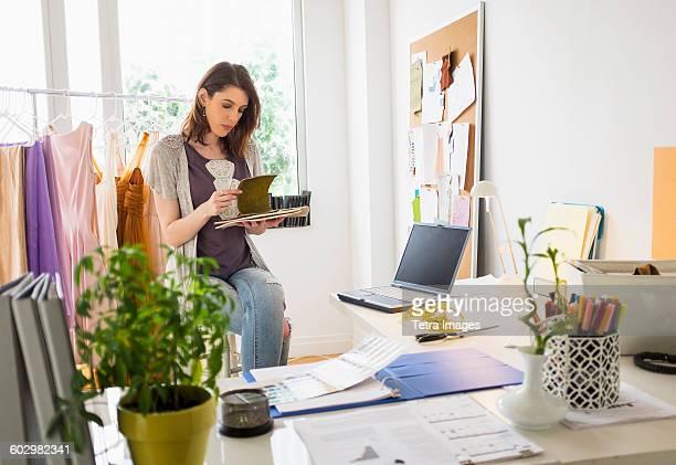 Female fashion designer in her office