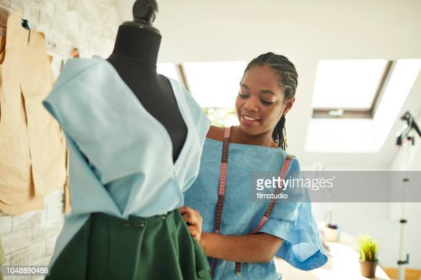 female fashion designer in her workshop - tailor stock photos and pictures