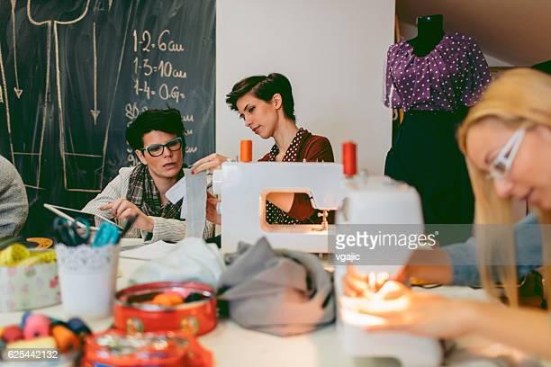 Female Fashion Designers Working In Their Workshop