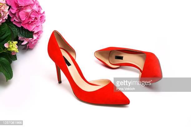 female fashion luxury outfit red shoes and flowers on white background. - salto alto - fotografias e filmes do acervo