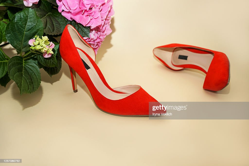 Female Fashion Luxury Outfit Red Shoes On Beige Background