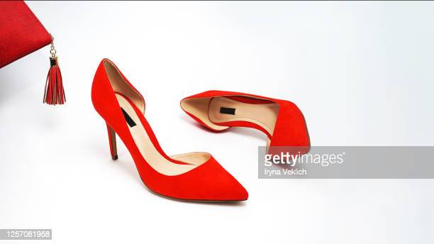 female fashion luxury outfit red shoes on white background. - red shoe stock pictures, royalty-free photos & images