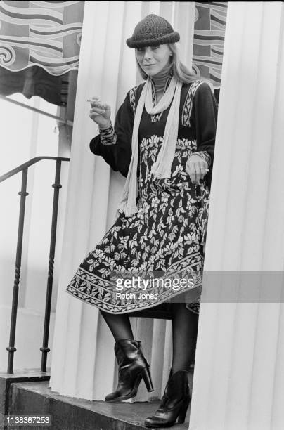 A female fashion model Denise Karen wearing midi printed dress scarf beanie and ankle boots UK 18th September 1975