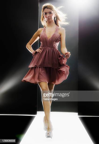 female fashion model wearing dress on catwalk - catwalk stock pictures, royalty-free photos & images