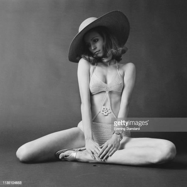 Female fashion model wearing knitted trikini and sun hat, UK, 19th May 1969.
