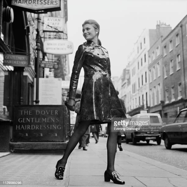 A female fashion model wearing patent leather coat Dover Street London UK 28th November 1968