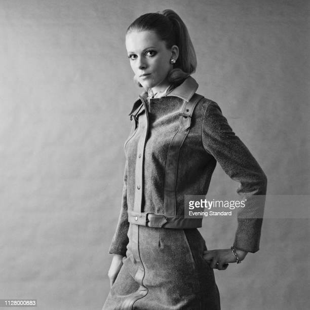 Female fashion model wearing suede jacket with belt details on shoulders and matching suede skirt, UK, 24th February 1969.