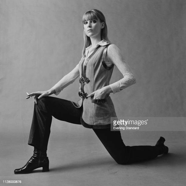 Female fashion model wearing suede waistcoat, black trousers and white lace shirt, UK, 24th February 1969.