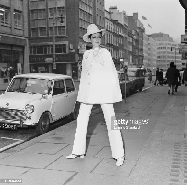 Female fashion model wearing white cape, white trousers and hat by French fashion designer Christian Dior, London, UK, 4th March 1969.