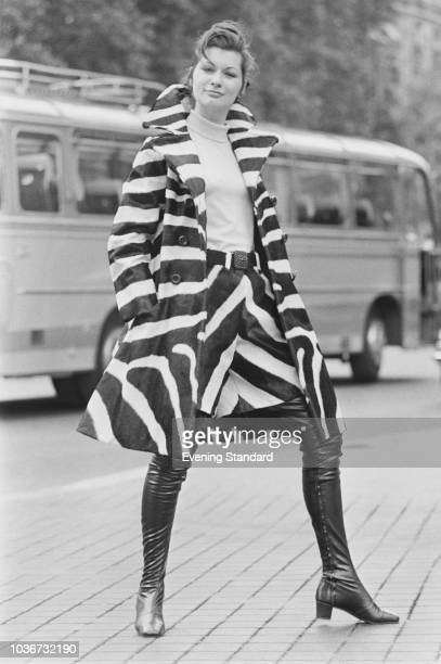 A female fashion model wearing zebra coat with matching culottes and overtheknee leather boots UK 30th July 1968