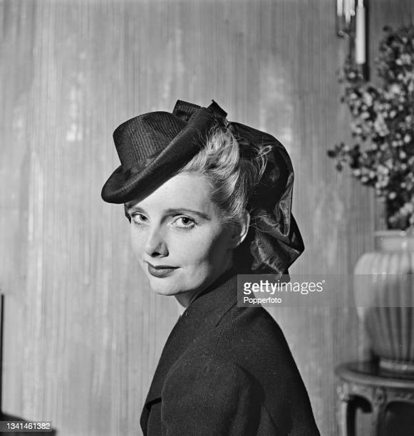 Female fashion model wears a hat from the new spring collection by the Condor hat company in England, 2nd March 1942.
