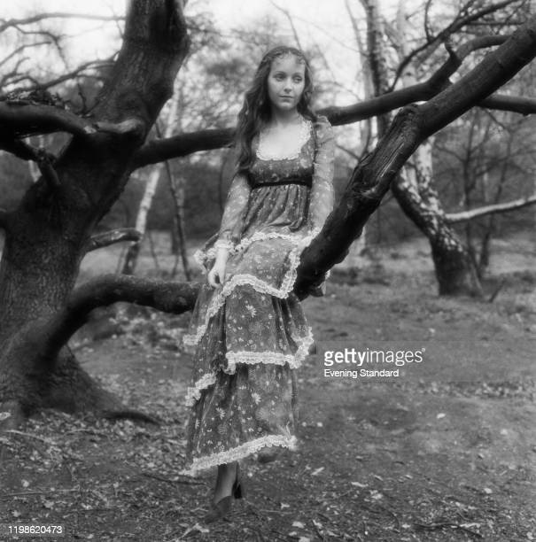 Female fashion model wears a layered maxi dress in a floral pattern with frilled lace lining, 3rd May 1971.