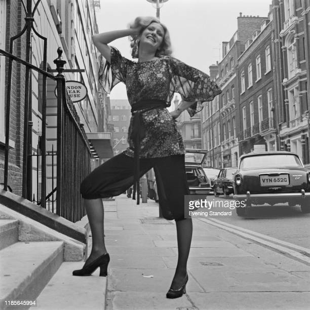 A female fashion model wears a tunic style blouse and knickerbockers on a street in London 3rd December 1970