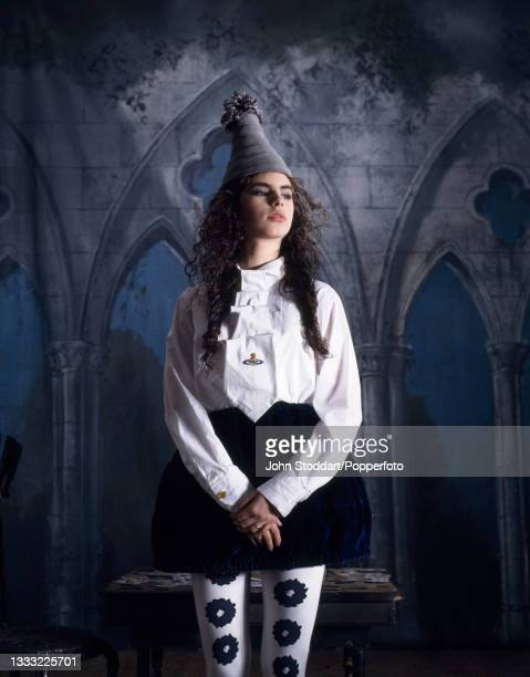 Female fashion model wears an outfit by John Galliano and Vivienne Westwood, comprising a white Vivienne Westwood blouse with concertinaed ruffle...