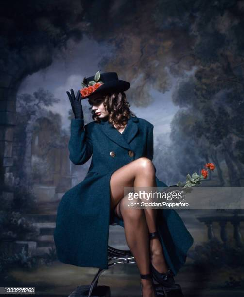 Female fashion model wears an outfit from the autumn/winter Harris Tweed Collection by Vivienne Westwood, comprising a double breasted frock coat in...