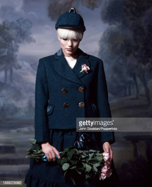 Female fashion model wears an outfit from the autumn/winter Harris Tweed Collection by Vivienne Westwood, comprising a double breasted jacket in blue...