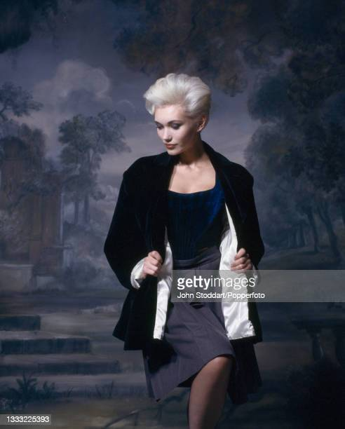 Female fashion model wears an outfit from the autumn/winter Harris Tweed Collection by Vivienne Westwood, comprising a blue velvet bustier corset, a...