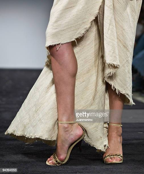 female feet pose - gold sandals stock pictures, royalty-free photos & images
