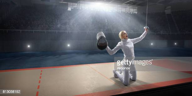 female fencer emotionally rejoices victory on the big professional stage - face guard sport stock pictures, royalty-free photos & images