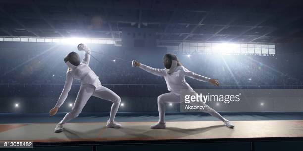 female fencer fight on big professional stage - face off sports play stock photos and pictures