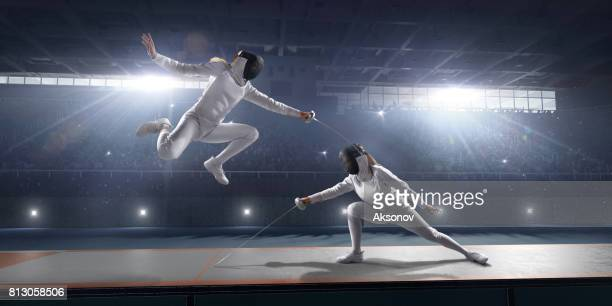 Female fencer fight on big professional stage