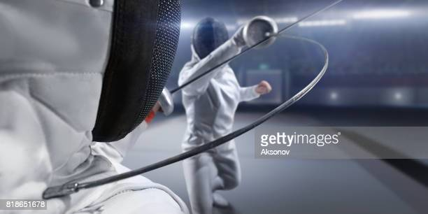 female fencer fight on big professional stage - flexibility stock pictures, royalty-free photos & images