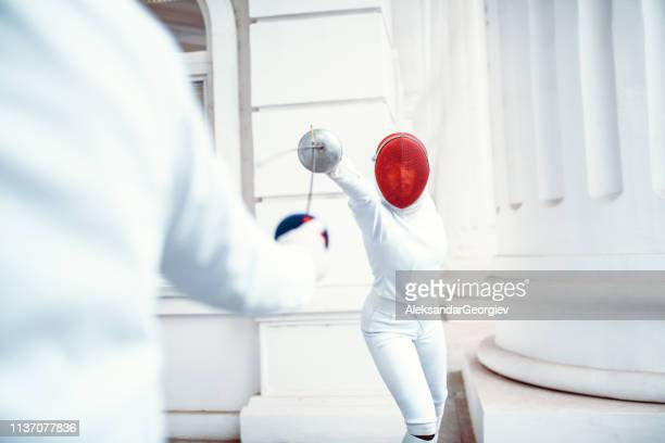 Female Fencer Preparing To Defend Herself