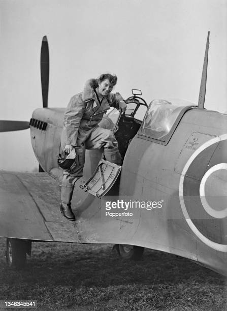 Female ferry pilot, possibly Louise Schuurman, of the Air Transport Auxiliary , prepares to climb in to the cockpit of a Royal Air Force Supermarine...