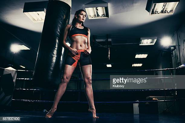 Female figher in a boxing ring